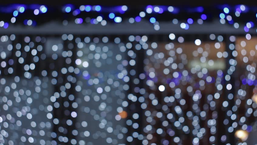 Ungraded: Bokeh from flashing garlands on shop window. Source: DSLR, ungraded H.264 from camera without re-encoding. (av2592u) | Shutterstock HD Video #13697996