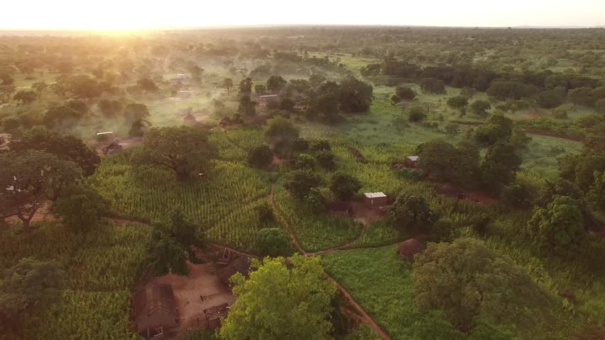 High aerial 4K sunrise over African village