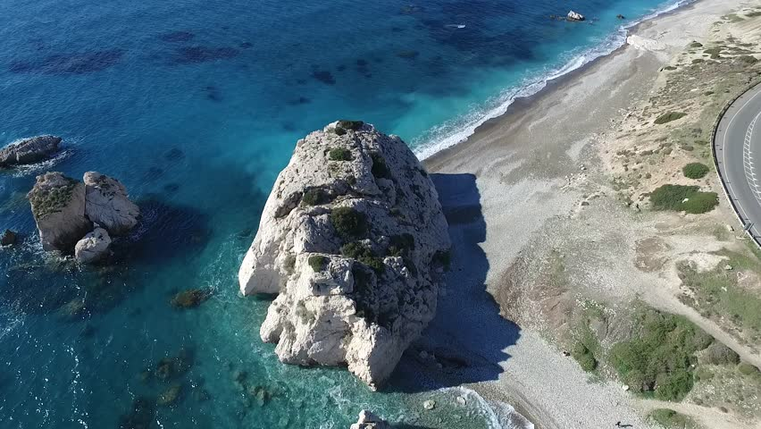Huge rock in the sea near the shore, magnificent aerial view, blue crystal clear water, Cyprus sea shore, nature beauty