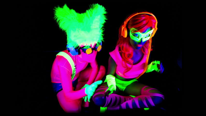 Fantastic video of sexy cyber raver man and woman filmed in fluorescent clothing under UV black light | Shutterstock HD Video #13737698