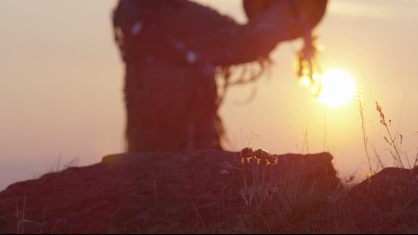 Khakas shaman performs ritual at sunrise
