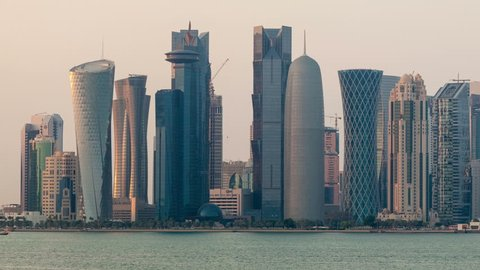 Doha skyline time lapse video from day to night with panning effect. Qatar, Middle East