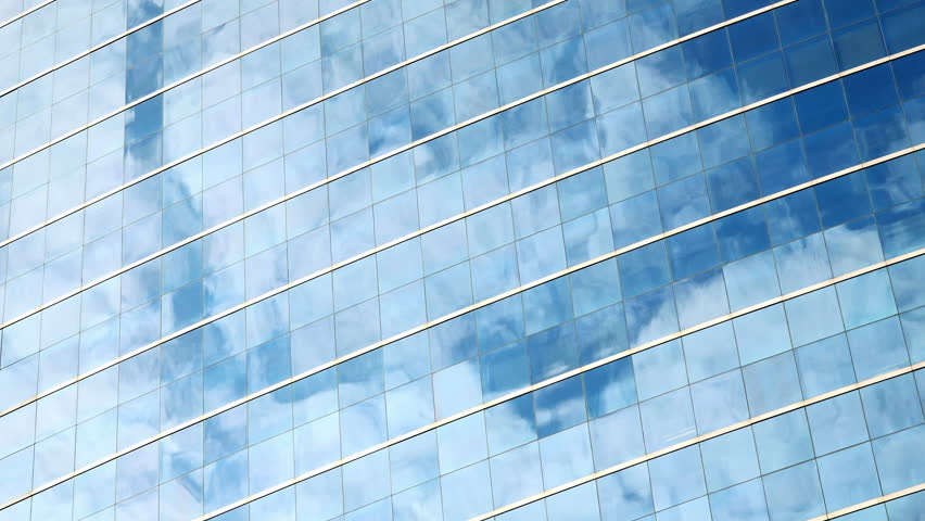 4K Time Lapse of Clouds Refelected in Modern Office Building. 4K Ultra HD 3840x2160 Video Clip