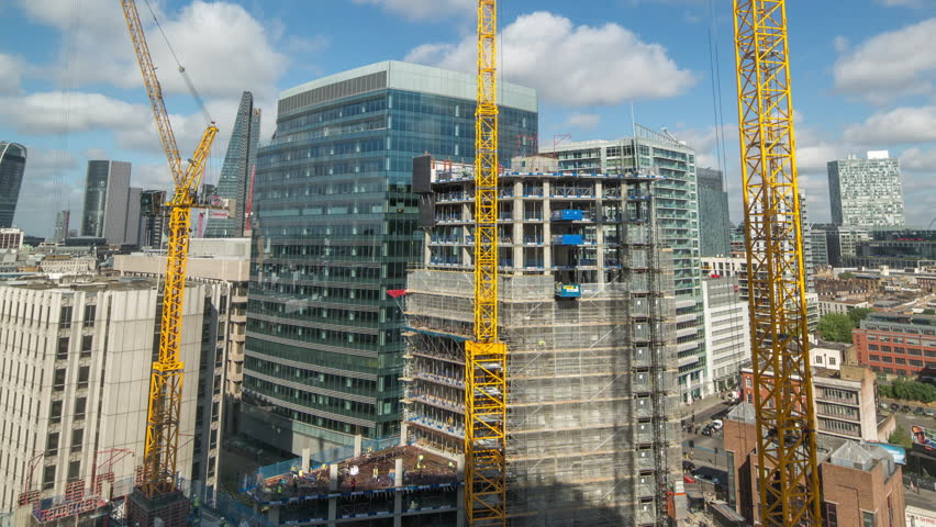 View from a high vantage point of the london city skyline with lots of cranes and construction of new buildings. | Shutterstock HD Video #13788566