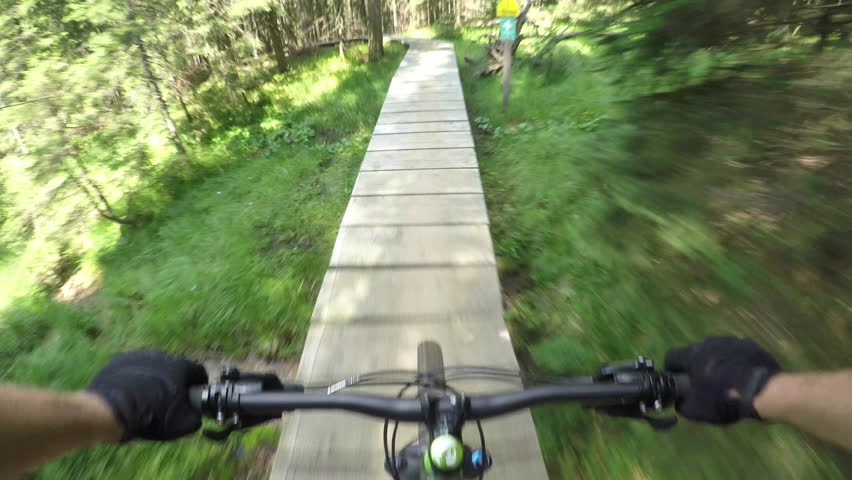 FIRST PERSON VIEW POV: Extreme downhill biker riding on wooden bike trail track | Shutterstock HD Video #13811321