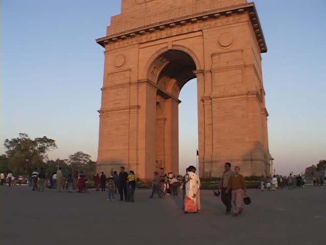 NEW DELHI - CIRCA 2010: Pedestrians walk near the India Gate circa 2010 in New Delhi, India.