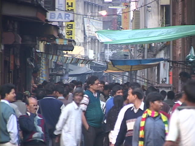 CALCUTTA - CIRCA 2010: People crowd a shopping district circa 2010 in Calcutta, India.   Shutterstock HD Video #1384096
