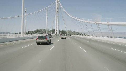 Bay Bridge: San Francisco, CA USA Set 9 - Driving Plate Direct Front angle: Car travels W on San Francisco Bay Bridge on a clear day in light traffic. Shot on RED Dragon.