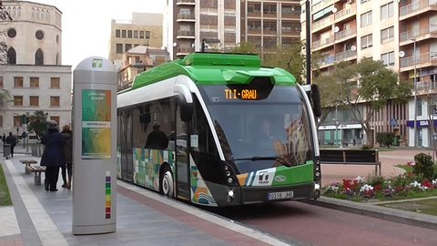 CASTELLON, SPAIN - 2016: People rise to an electric bus also known as TRAM.