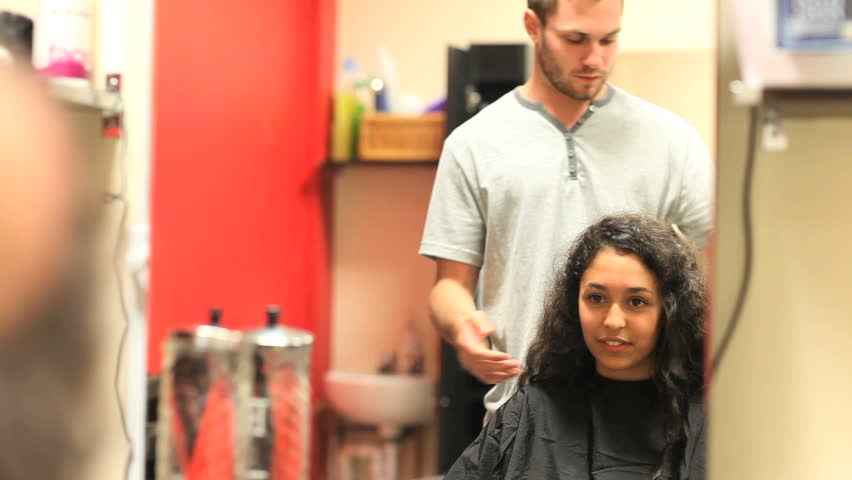 Student having an haircut in a hairdressing salon