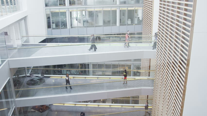 4k / Ultra HD version Business people walking along different floors of large contemporary office building. Shot on RED Epic | Shutterstock HD Video #13951226