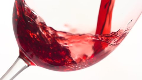 Red Wine Pouring into Glass. White Background. Slow Motion Shot 400 fps