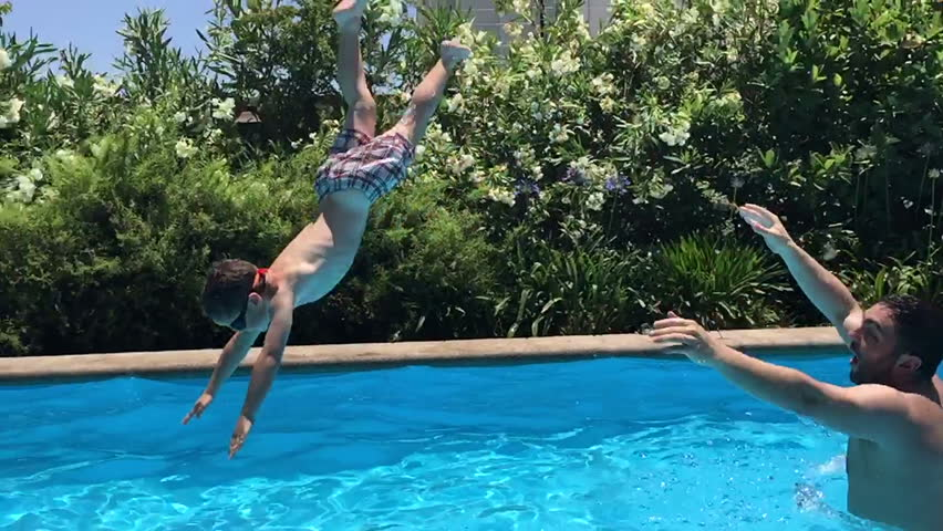 Boy And Father Diving In Swimming Pool Slow Motion Perfect For Videos About Swimming Pools