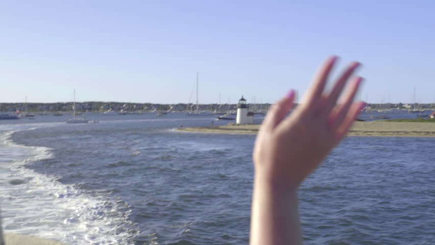 Young Woman Waves Goodbye To The Historic Nantucket Island In Massachusetts
