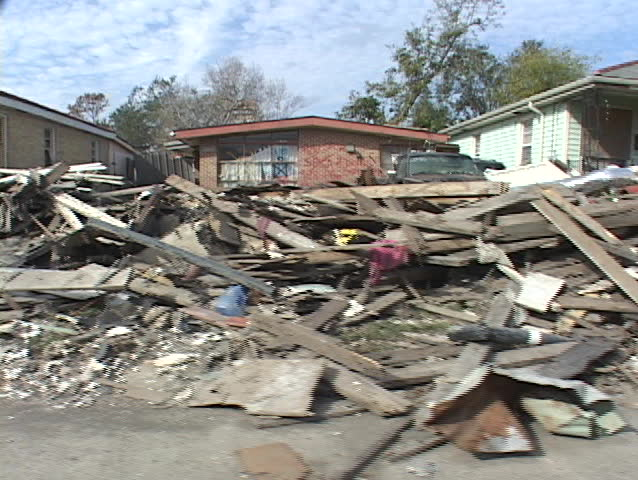 Rubble and debris piled along the side of the road shows the destruction caused by Hurricane Katrina.