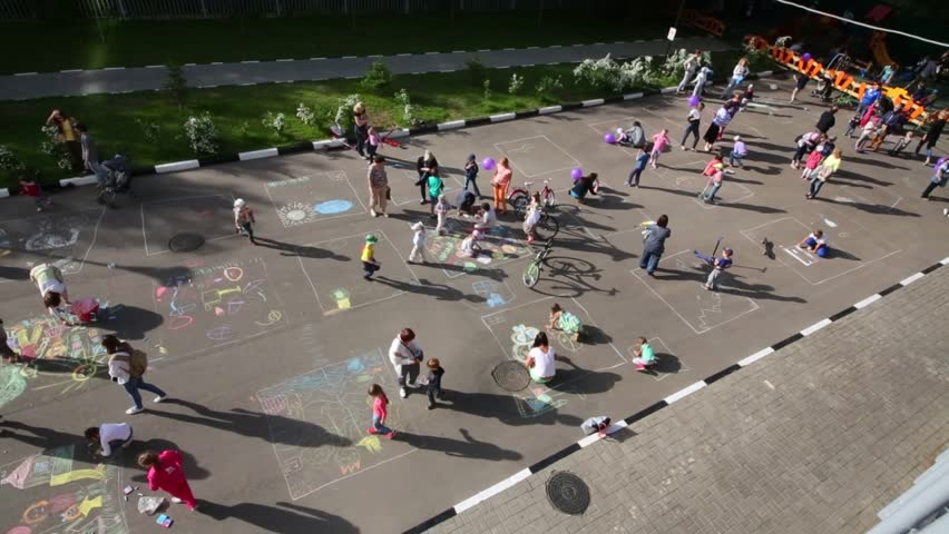 Top view of children, parents drawing with chalk on pavement #14027846