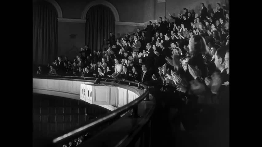 Side view of audience in balcony fervently applauding, 1940s #14031332