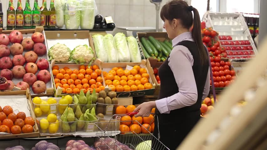 Woman selecting fruit at market and adds to cart, rear view | Shutterstock HD Video #14040110