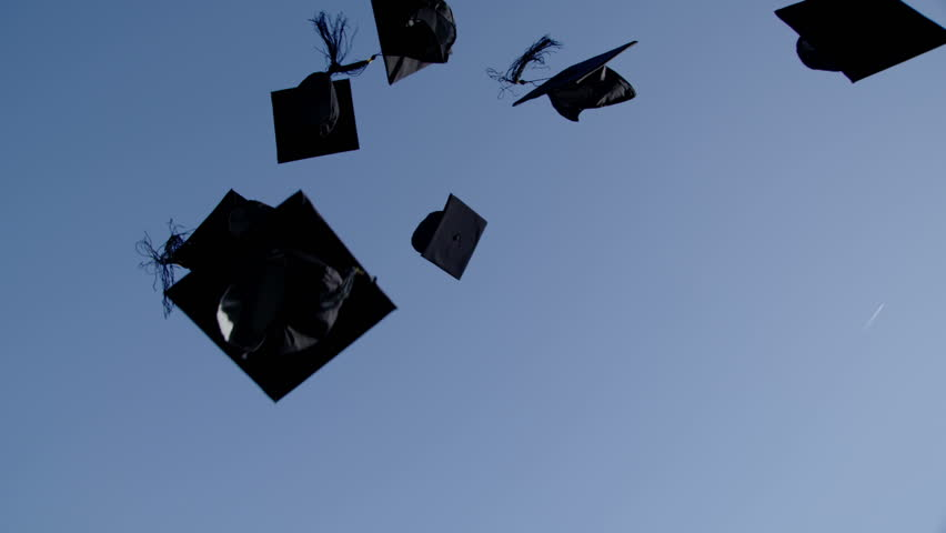 4k / Ultra HD version Graduation caps are tossed into the air on a bright sunny day and then fall out of shot. No people can be seen. In slow motion. Shot on RED Epic