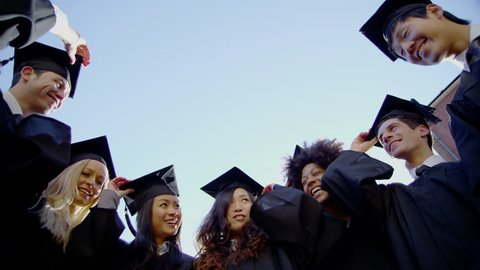 4k / Ultra HD version Graduation caps are tossed into the air by a happy multi-ethnic group of friends on a bright sunny day. In slow motion. Low angle. Shot on RED Epic