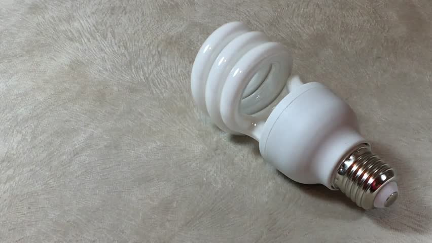 Spiral shape white lamp bulb. | Shutterstock HD Video #14070116