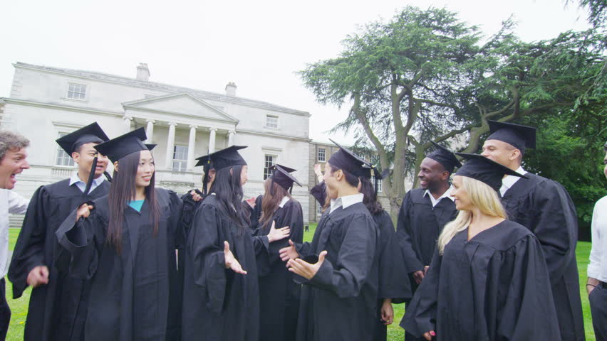 Portrait of excited mixed ethnicity group of friends on graduation day with their parents or teachers. They are outdoors on campus in a natural green landscape with university building. In slow motion | Shutterstock HD Video #14102426