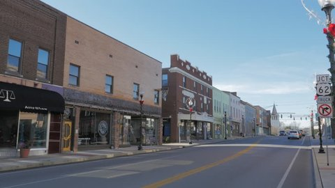 Elizabethtown Kentucky dolly cinematic moving slowly beside main street with small town shops and 20th century storefronts.
