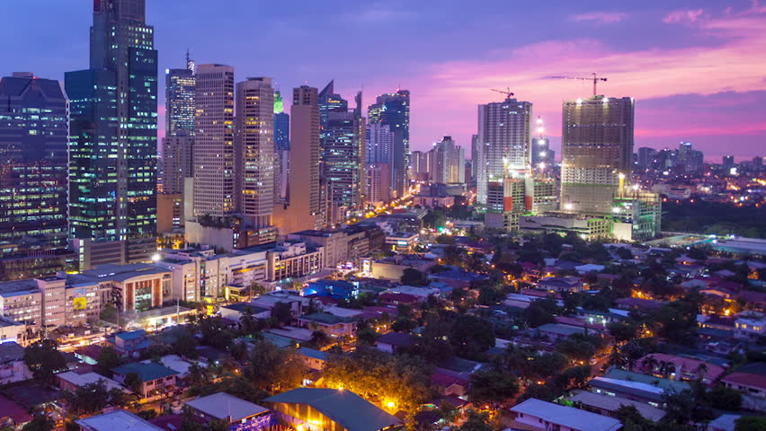 Timelapse view over Makati city in Metro Manila, Philippines by night