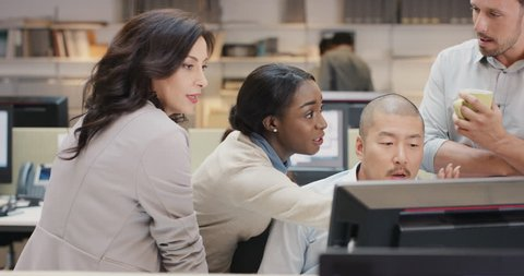 African american business woman leading Creative business team meeting.Happy people working in modern office at night discussing strategy using computer touch screen in diverse gender group