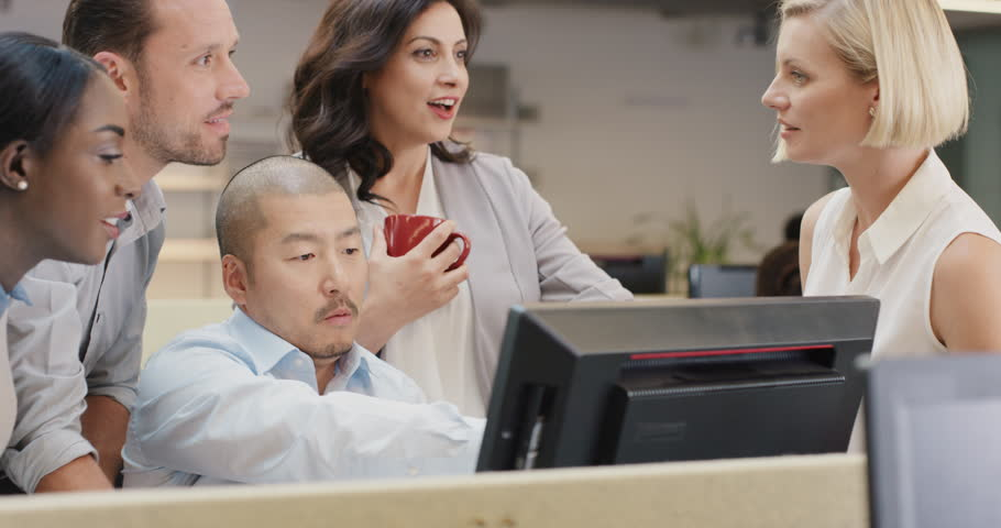 Creative business team meeting happy people working in modern office late at night discussing strategy using computer touch screen in diverse gender group | Shutterstock HD Video #14141816