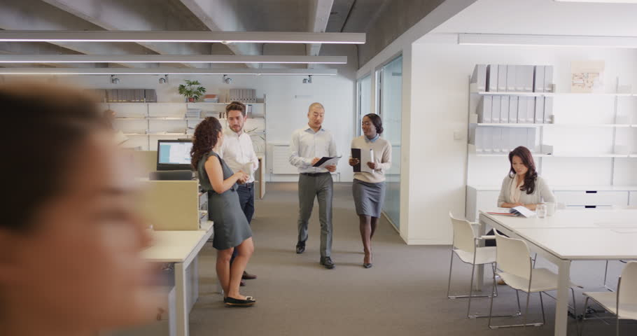 Congratulations businessman receiving praise as team members clap in applause celebrating victory on return to office slow motion walk POV shot concept series