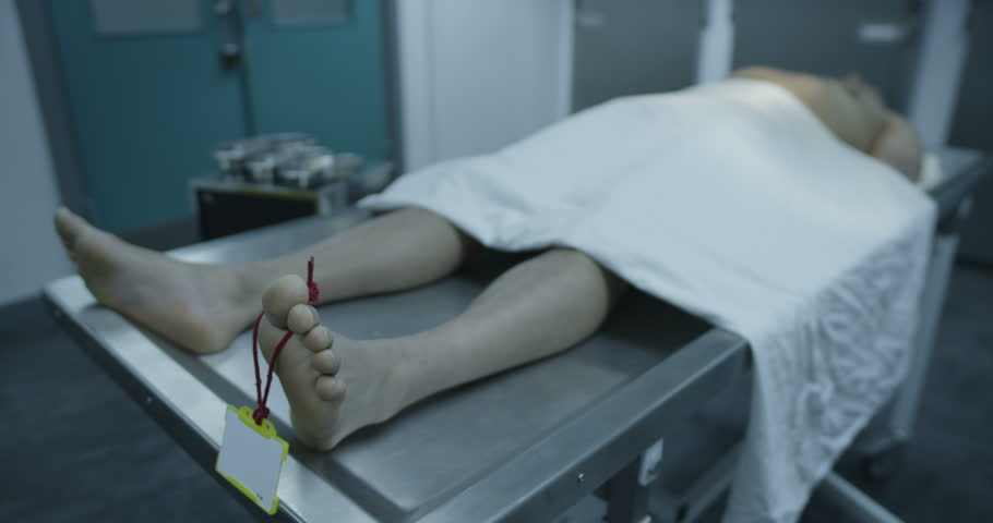 4k / Ultra HD version The lifeless naked body of a young mixed race male is laid out on the autopsy table, ready for the medical examiner to begin his work. In slow motion. Shot on RED Epic