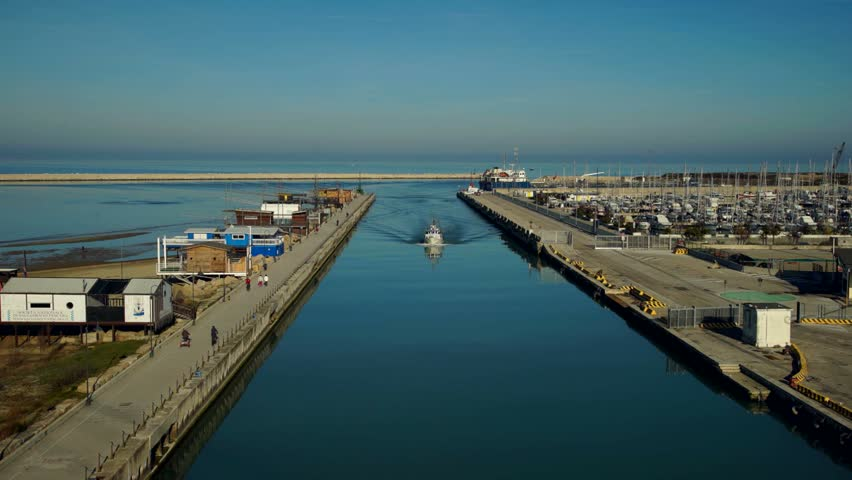 Time lapse of fishing boat coming back to harbor at dusk. Pescara, Italy.   Shutterstock HD Video #14144885