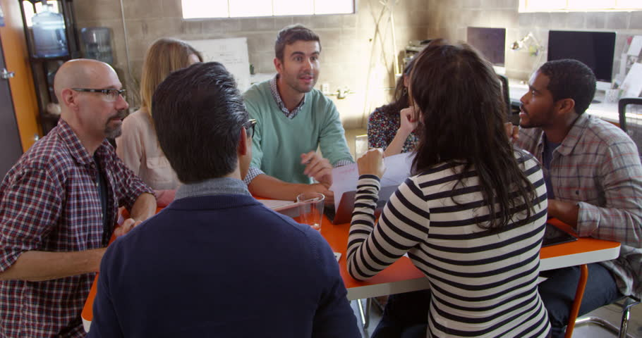 Designers Having Meeting Around Table In Office Shot On R3D | Shutterstock HD Video #14170163