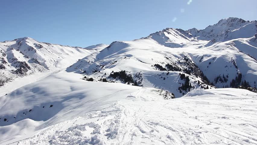 Slow panorama from the top of the mountain in the ski resort of Karakol, Kyrgyzstan, Karakol, 2015 | Shutterstock HD Video #14184749