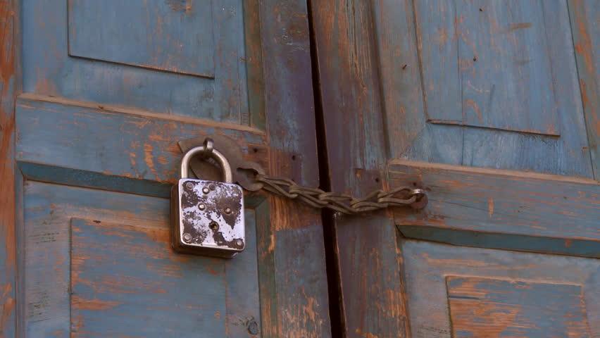Kalsuin India - CIRCA 2013 - Closeup view of padlocked door - HD stock video & Old Metallic Padlock On The Wooden Door Stock Footage Video ... Pezcame.Com