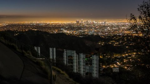 LOS ANGELES, CALIFORNIA, USA - January 24, 2016:  Editorial sunrise time lapse with zoom from the back of the Hollywood Sign in popular Griffith Park.