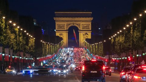 PARIS - MAY 2015: Traffic on Champs Elysees at night