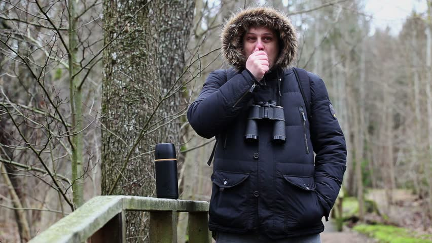 Ornithologist drinking tea in park
