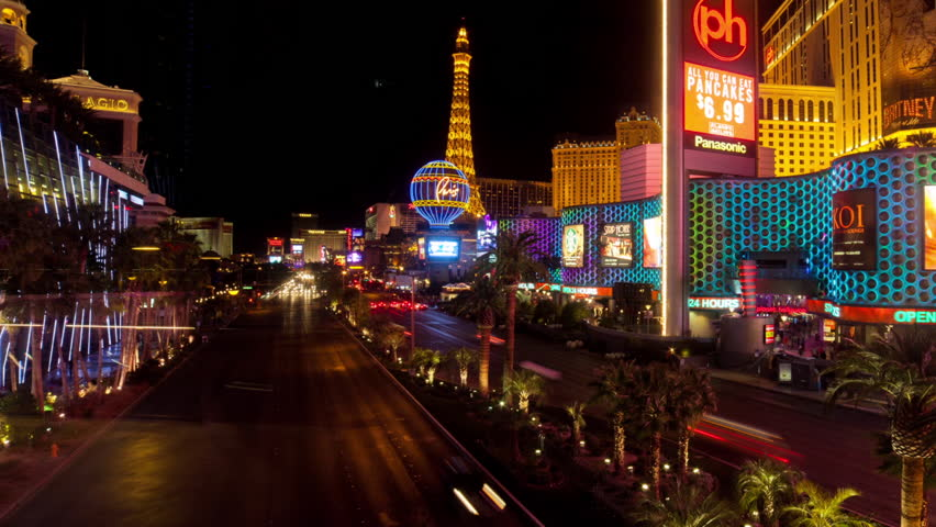 LAS VEGAS - FEB 2014: Itimelapse view over Las Vegas Strip and Bellagio fountain at night on 14 February 2014 in Las Vegas USA   Shutterstock HD Video #14232506