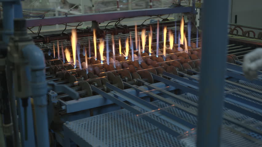 Attractive Glass Tubes Passing Through Flames, Manufacturing Process. (Compact  Fluorescent Lamp Factory) Wide Shot. Stock Footage Video 14238656 |  Shutterstock