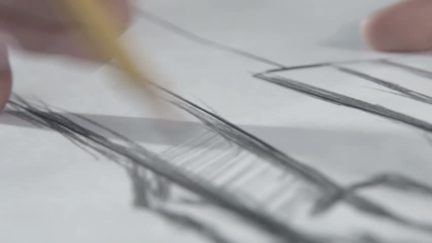 Hand of female tailor drawing pattern at paper in her studio. woman's hand draws a pencil. Designer clothes or tailor, animator, artist or illustrator. It looks like a geometry or drawing | Shutterstock HD Video #14239100