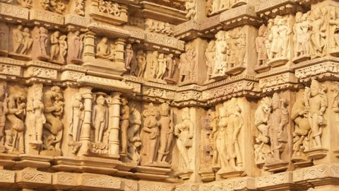 Sculptures of loving couples, mythical figures on outer walls of Parsavanatha, Jain Temple, Khajuraho in India, Asia