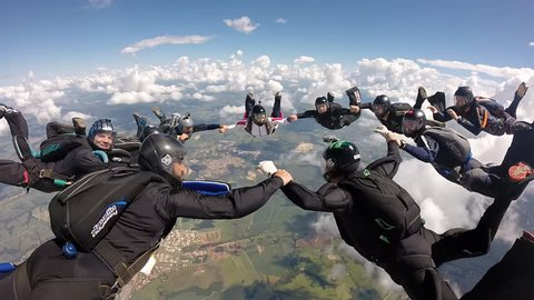 Skydiving holding hands