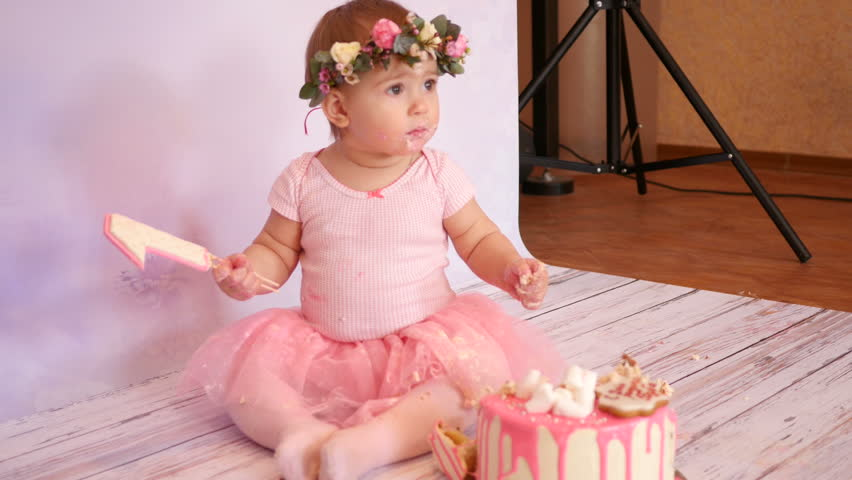 studio photo shoot of a little kid girl play with sweet cake of mastic 4k