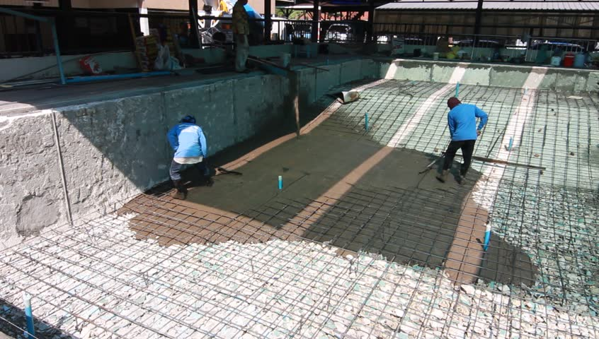 Swimming Pool Under Construction, Being Sprayed On Rebar For New Swimming  Pool