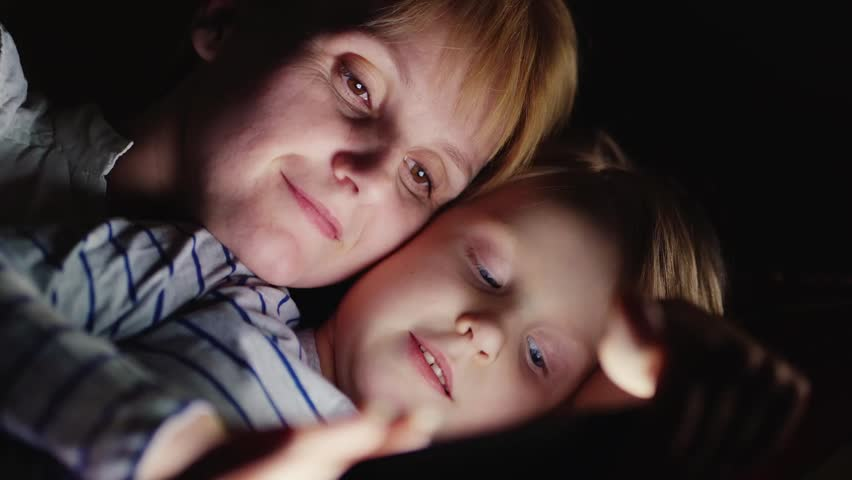 Portrait of a mother and daughter: use tablet   Shutterstock HD Video #14395876