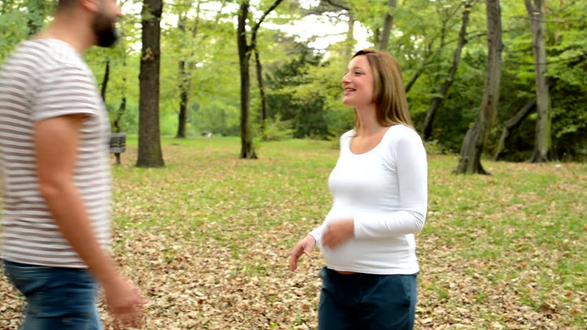Young pregnant woman waits for her husband (boyfriend) in park  | Shutterstock HD Video #14408176