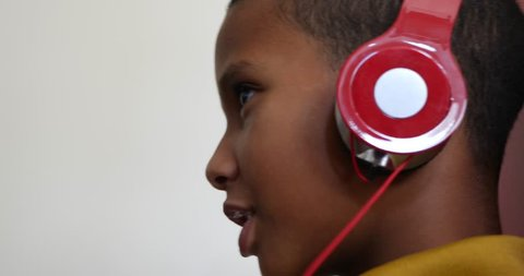 Brazilian child listening to music with a headsets