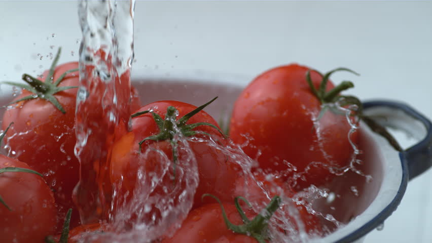 Water splashing onto tomatoes in slow motion, shot at 1000 frames per second on Phantom Flex 4K